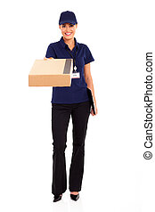 delivery worker delivering parcel - pretty female delivery...