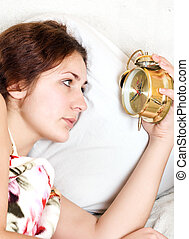 sleeping problems - clock with sleep at night woman can not...