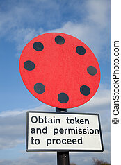 Transport token sign. - Railway warning symbol in red and...
