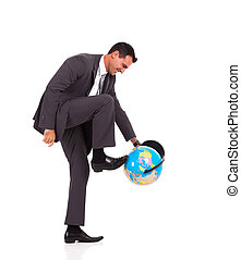 young businessman turning globe