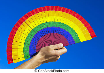 gay hand fan - someone holding a hand fan painted with the...