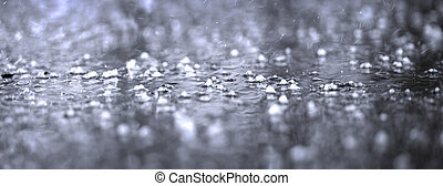 closeup of puddle on asphalt during heavy rain storm