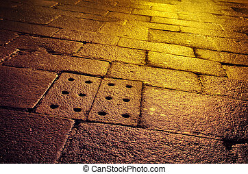 Wet Old Pavement - Closeup of an old street with wet stone...