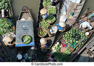 Floating fruit and vegetable market - Vegetable merchants at...