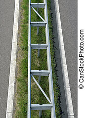 guardrail - Guard rail in the middle of a highway seen from...