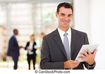 businessman with tablet computer - handsome businessman with...