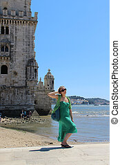 Young woman and Belem tower in Lisbon