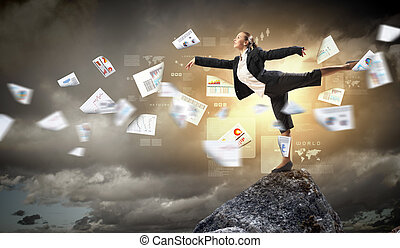 businesswoman standing atop of mountain - young...