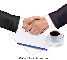 Handshake over paper and pen.
