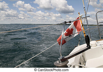 Canadian Flag on Sailboat - Canadian Flag flying on a moving...