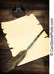 blank sheet of paper and quill - A blank sheet of paper and...