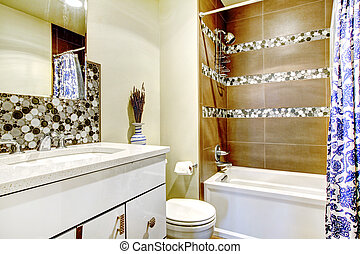 Modern bathroom with brown and blue interior.