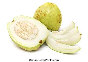 Guavas - Half guava and slices with the complete one on...