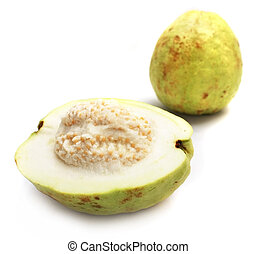 Guavas - Close up of half guava with the fullness one.