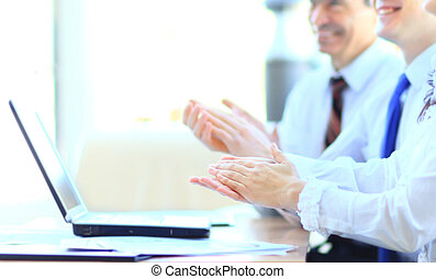 Cropped image of business people clapping hands during...