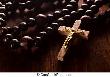 Rosary - Closeup of wooden cross and rosary