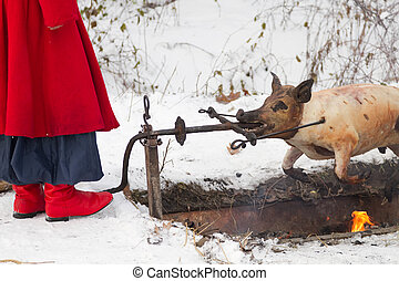 Ukrainian Cossack fries a pig - Ukrainian Cossack prepares a...