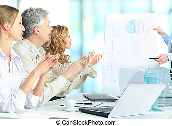 Cropped image of business people c - Cropped image of...