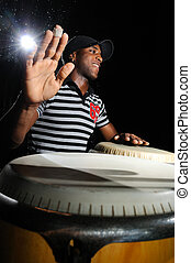 Drums player - Portrait of young cuban percussionist...
