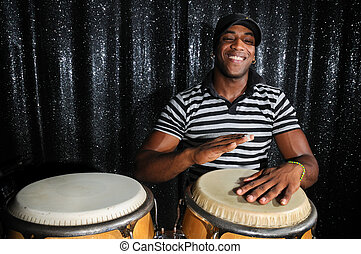 Cuban percussionist - Portrait of young latino percusionist...