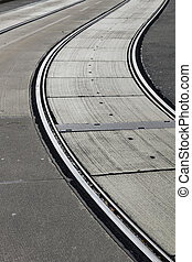 Tramlines - Silvery grey tramlines curve through street in...