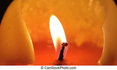 Candle closeup blown out - Macro shot of a candle being...