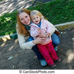 Mother with baby girl - Happy mother with 1 year old baby...