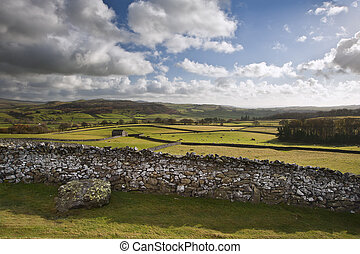 View across fields towards Wharfe Dale in Yorkshire Dales National Park