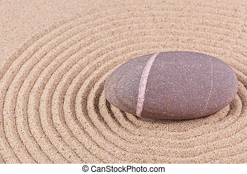 Pebble in a raked sand circle