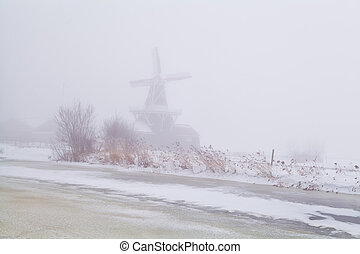 windmill in dense fog