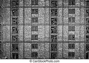 Broken windows in huge derelict warehouse. (Stanley Dock,...