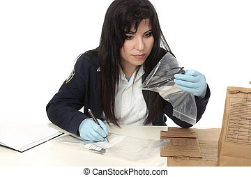 CSI documenting evidence - A detective with evidence from a...