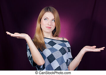 Young woman weighing choises on both hands - Young beautiful...