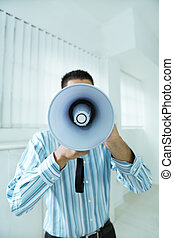 megaphone - young businessman in office screaming on the...