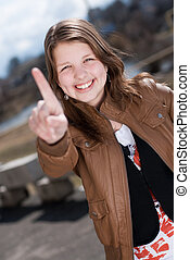 Happy teen girl showing one - Happy beautiful smiling...