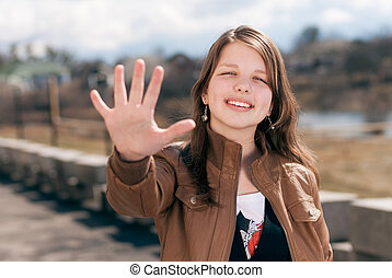 Happy teen girl showing five - Happy beautiful smiling...