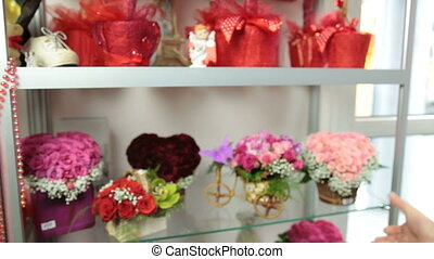 Serving Customer in Flower Shop - Florist Serving Customer...