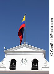 Government building and waving flag of Ecuador in Quito,...