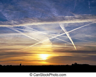 airplane vapour trails - Evening sky in Holland with...