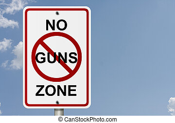 No Guns Zone - An American road sign with sky background and...