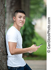 handsome asian student using tablet - Portrait of young...