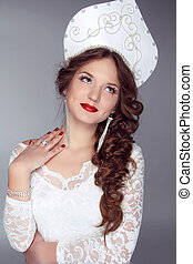 Russian Beauty. Attractive female wearing in kokoshnik....