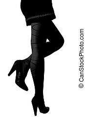 Silhouette of woman legs in heels boots isolated on white background