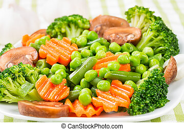 Steamed vegetables - carrots, broccoli, peas, green beans.