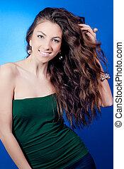 Beautiful young woman with long wavy hair - Beautiful young...