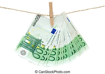 Laundering Money - Several one hundred euro bills held by a...