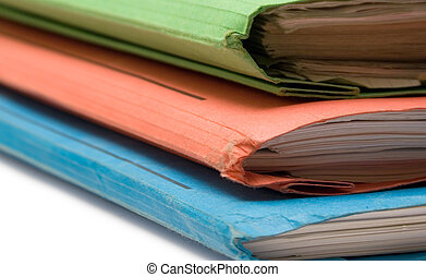Three Colorful Binders - Stack of colorful binders full of...
