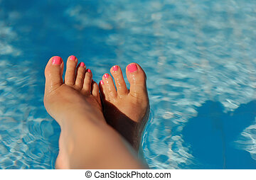 beautiful pedicure - bare female feet with pink nails...