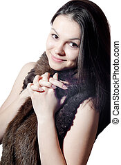 Beautiful young woman in fur coat