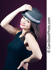 Beautiful young woman model in hat